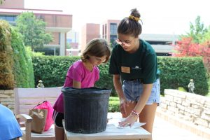 Intern Assisting Child with Art Project