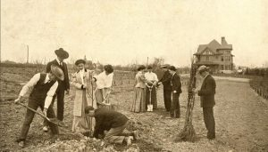 Old Photo of Student's Planting in a Field with Dean's Residence in Background