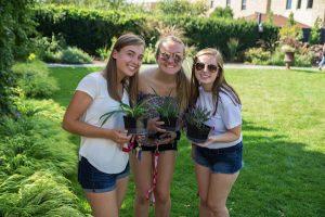 Three students at Plant Adoption Day